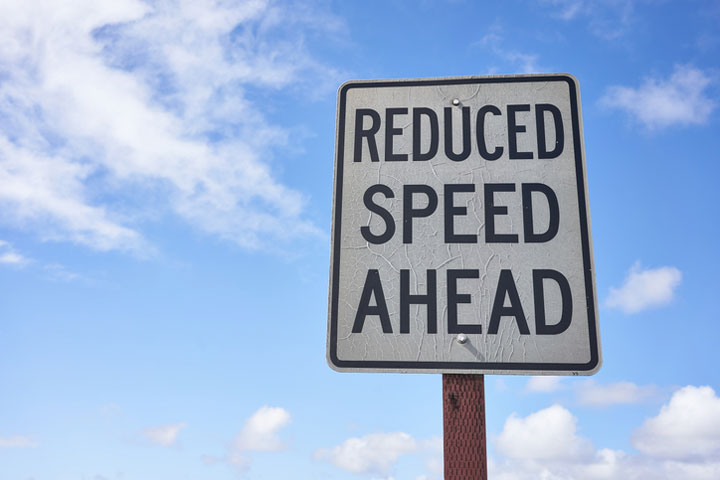 Calgary traffic sign saying reduced speed ahead
